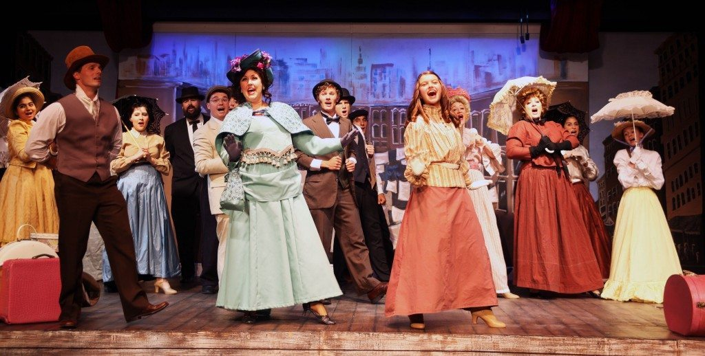 Cast members of Hello, Dolly sing and dance across Limelight's stage this summer.