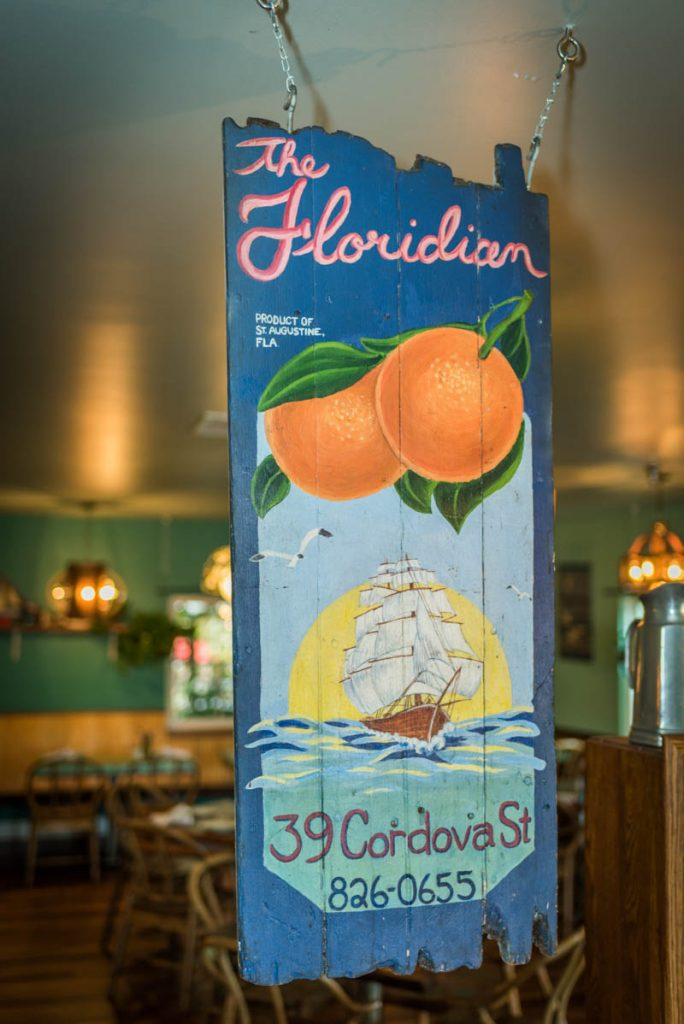 a painted wooden sign at the floridian restaurant in st augustine