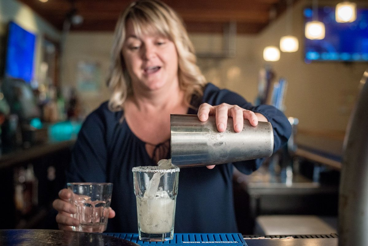 angelika pours drinks behind the bar at zaharias st augustine
