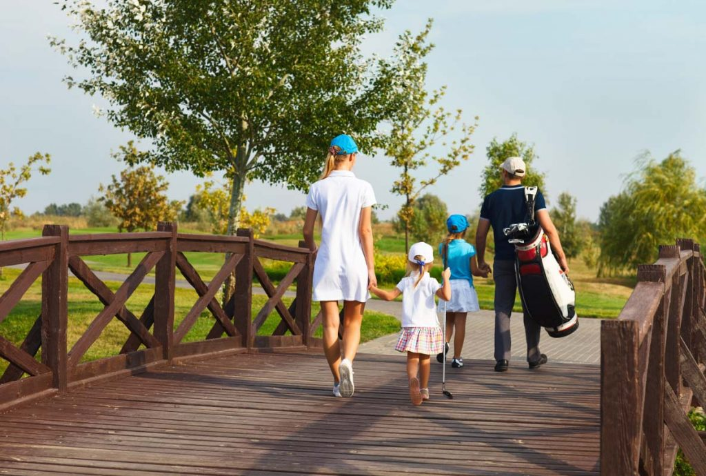 st johns county family walks across neighborhood golf course