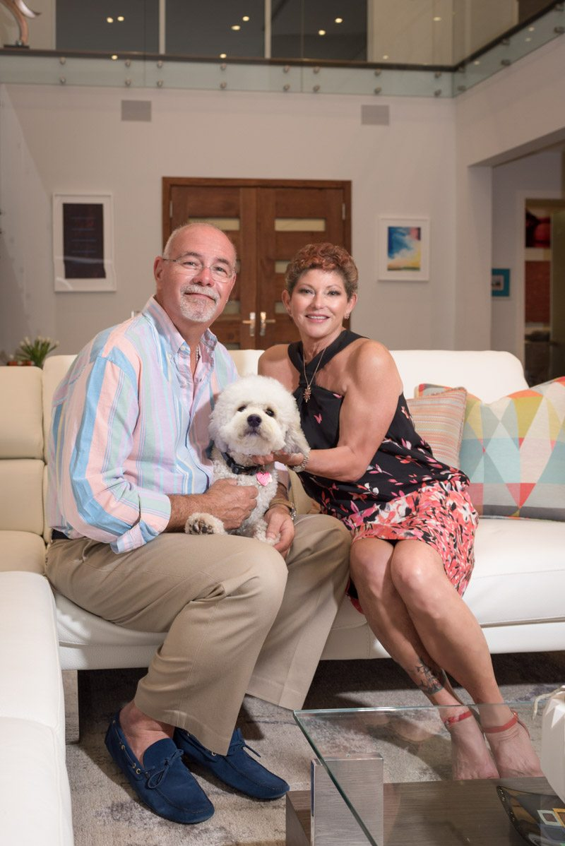 Brad and robin cooper pose in their st augustine inlet home with bailey the dog