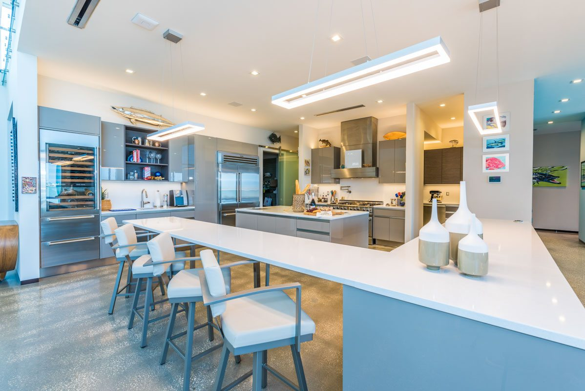 modern luxury with an artist s touch the cooper s waterfront white modern open kitchen with stainless steel appliances