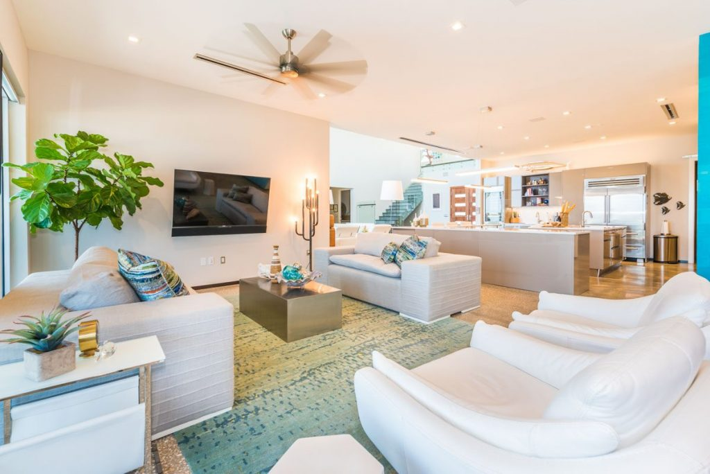 white modern furniture and seafoam decor in a open floor plan living space