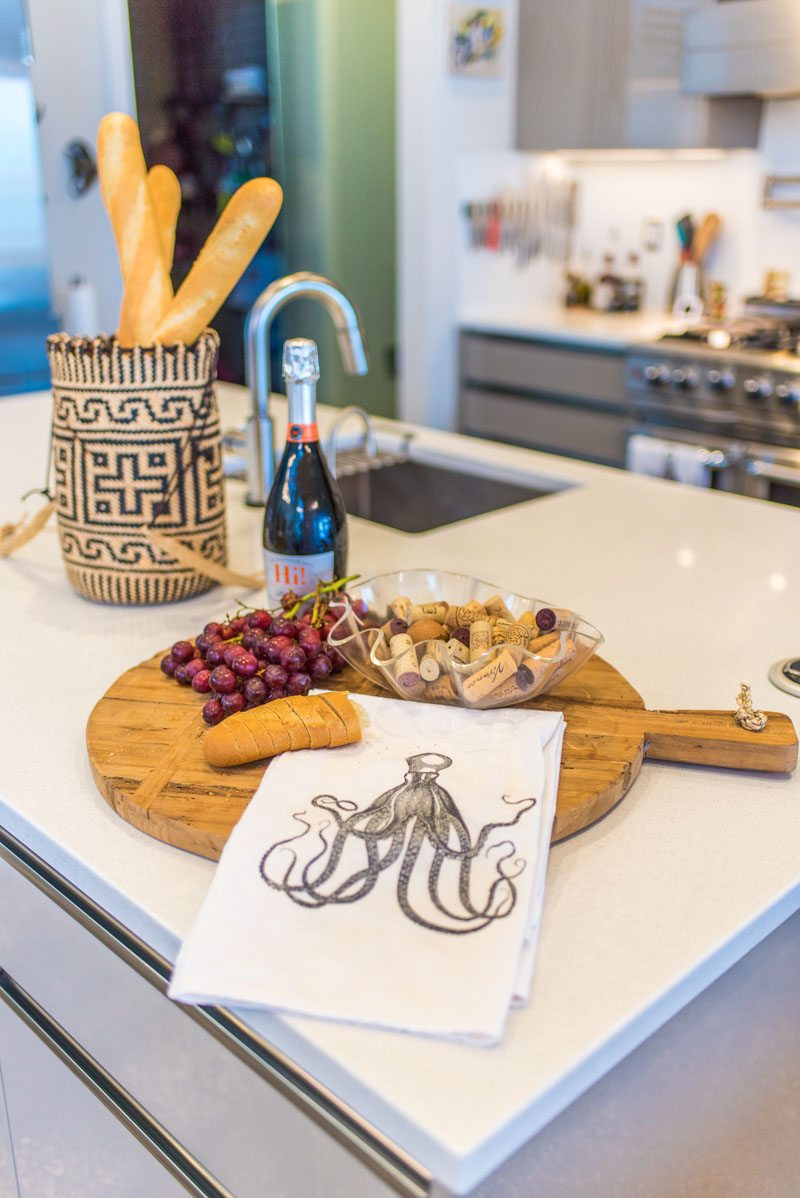 modern kitchen with hors d'oeuvres and octopus tea towel