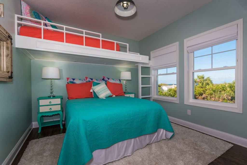 teal and red bedroom decor with built in bunk beds