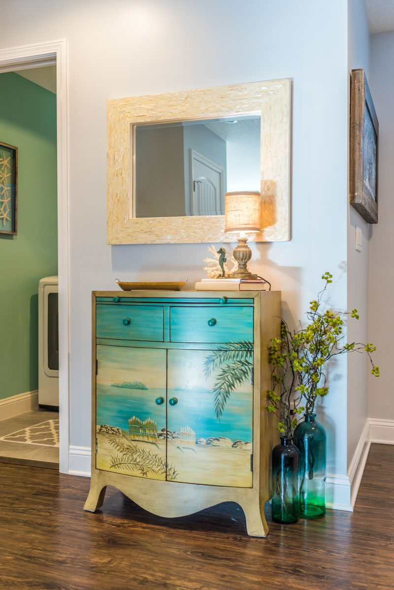 nautical mirror and painted mural dresser design details