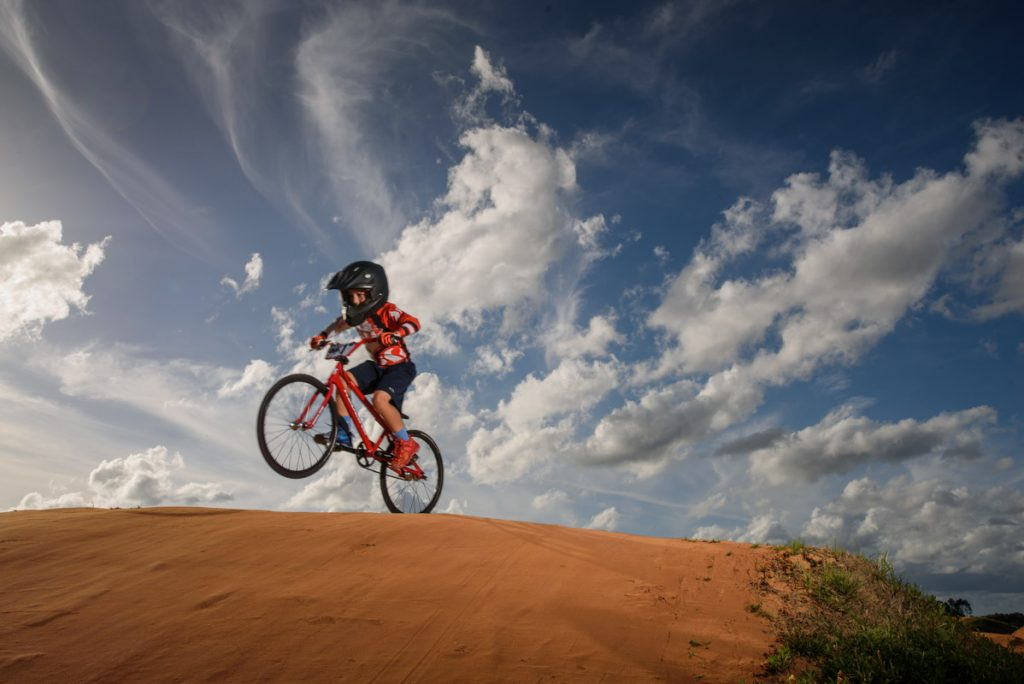 young first coast bmx rider takes to the air on the track