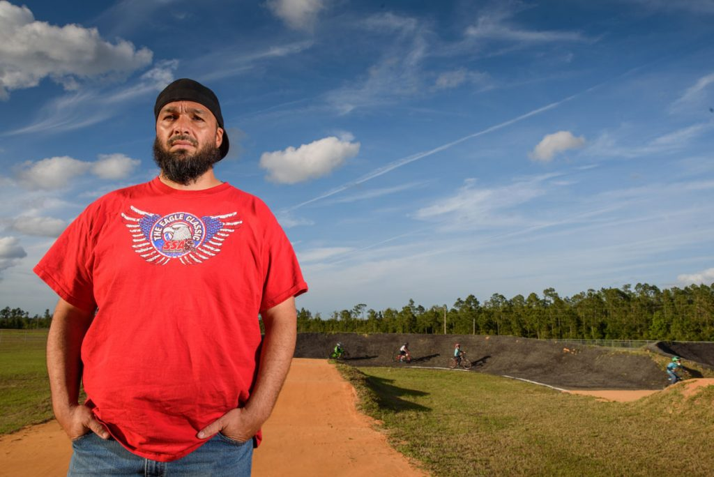 first coast bmx owner anthony sargent stands on the track