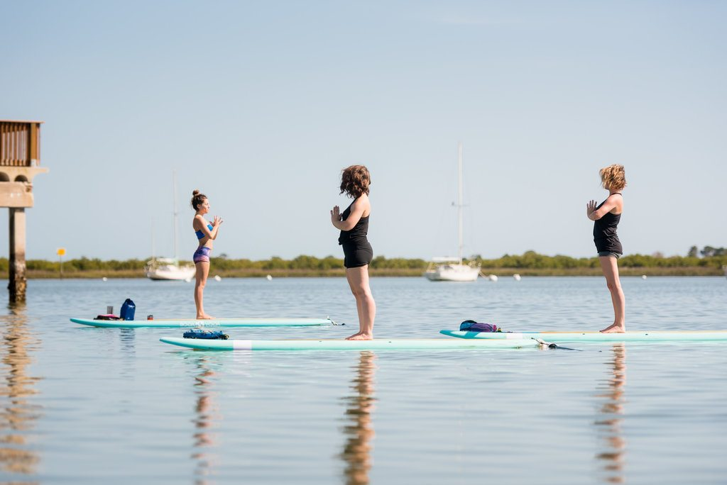 st augustine social team tries yoga on the water with sup yoga center