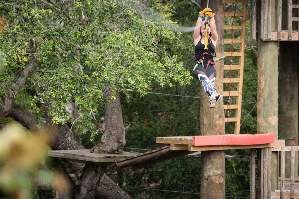 swinging down the line at alligator farm zip line st augustine
