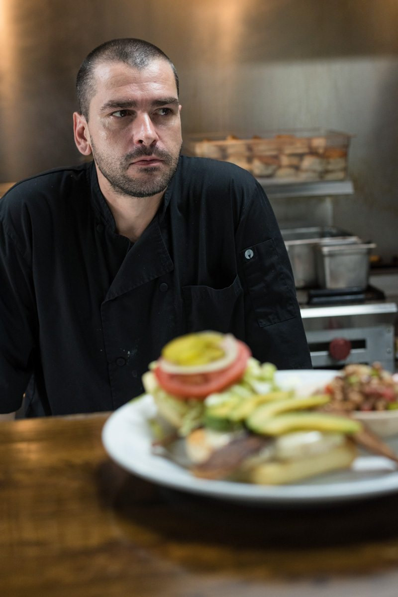 ivan stoyanov of anastasia diner stands behind the line with some of his menu items