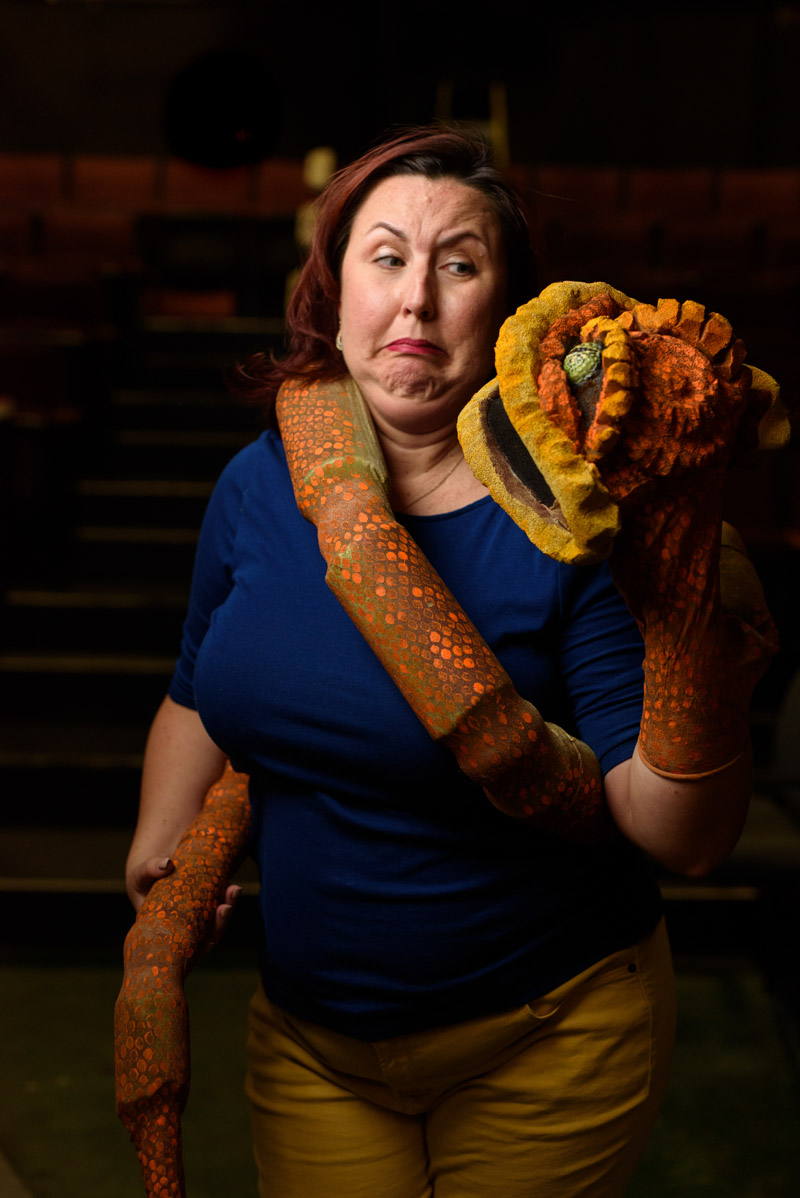 kristin pidcock poses with a costume snake at limeligh theatre in st augustine florida