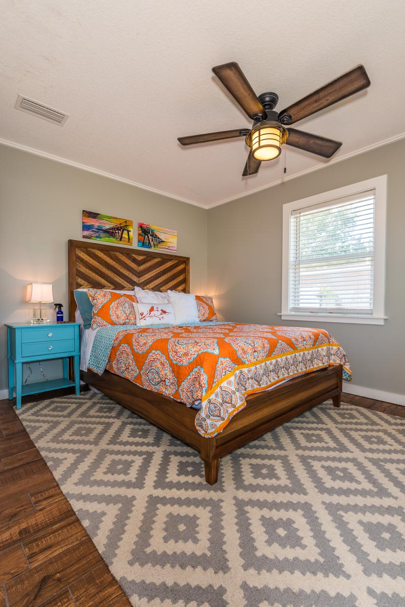 orange and blue bedroom with natural accents st augustine