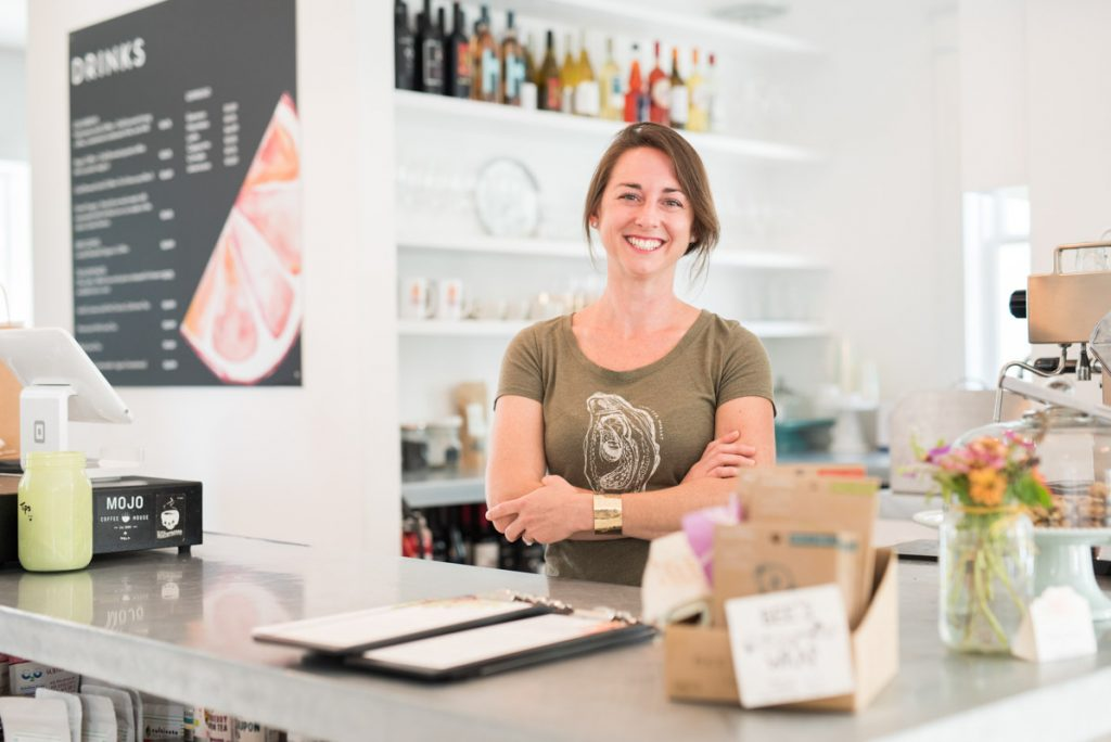 jennifer myers stands behind the counter at juniper market st augustine