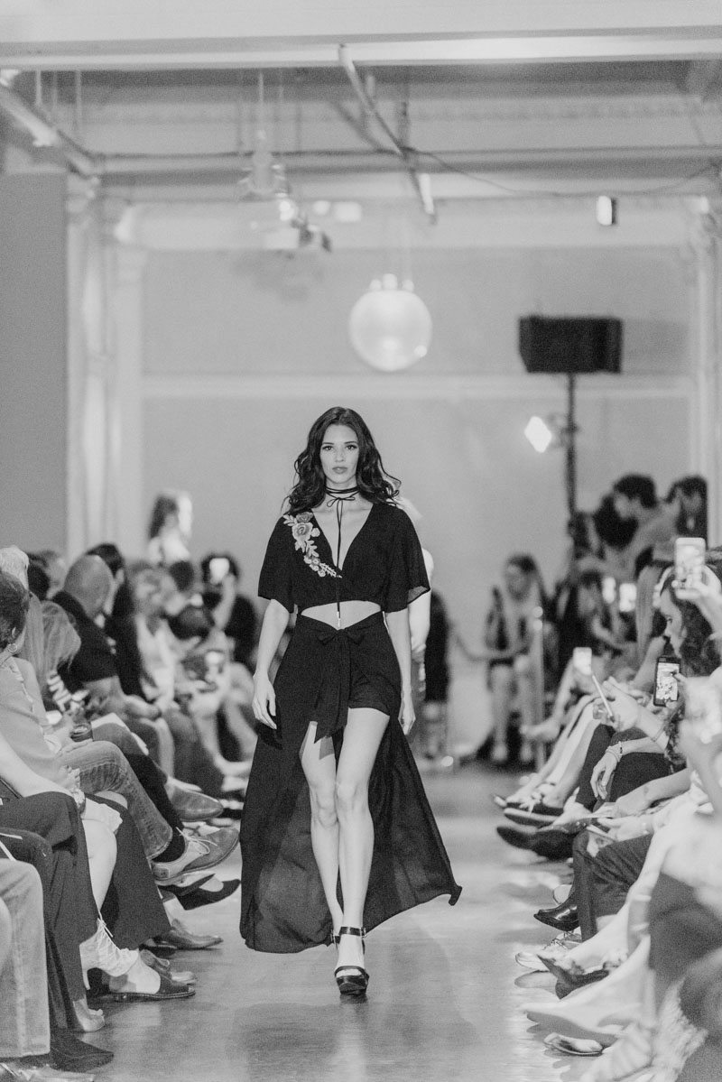 a model walks the runway at st augustine fashion week 2017