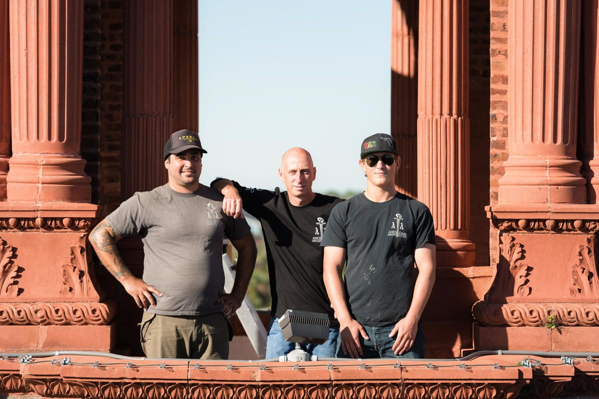 chris fitts of angels in the architecture stands with his crew