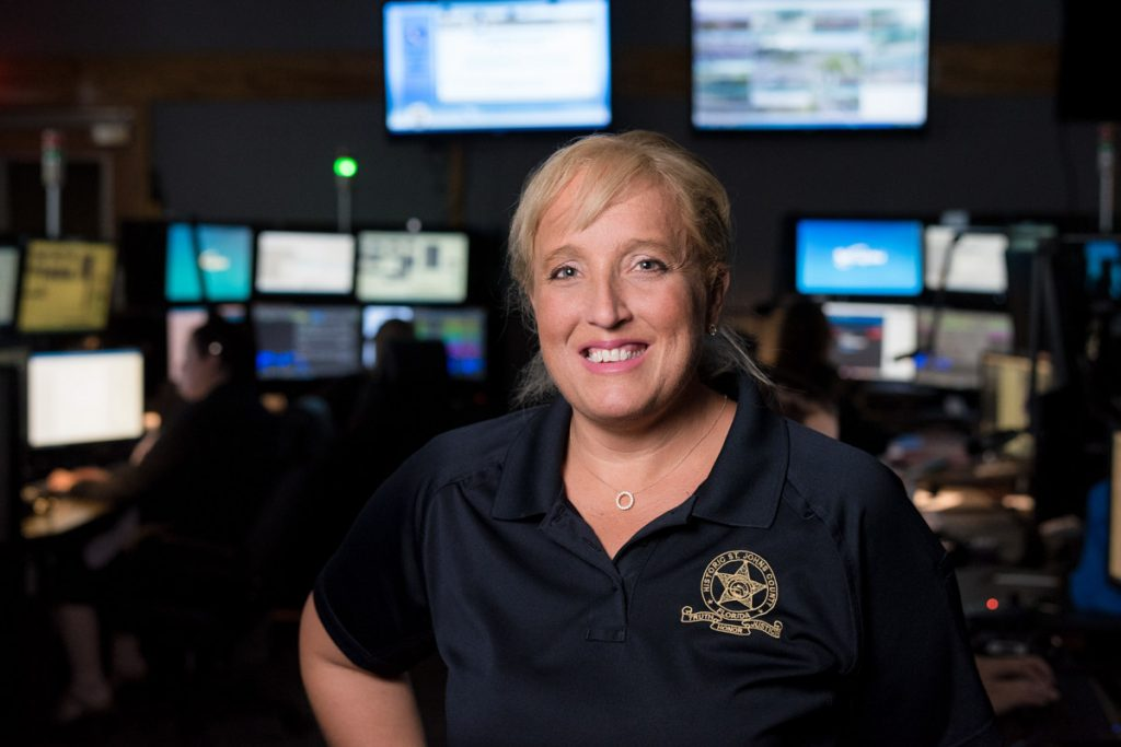 christie taylor stands in the st johns county dispatch center