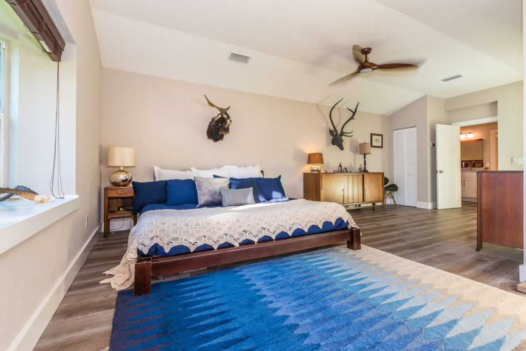 blue and white midcentury bedroom in st augustine florida home