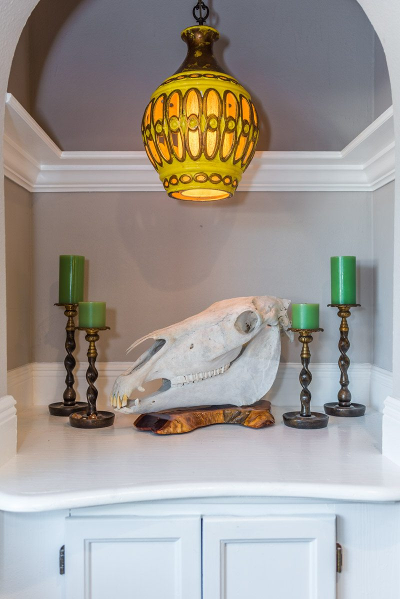 skulls candles and gold lamp in st augustine home