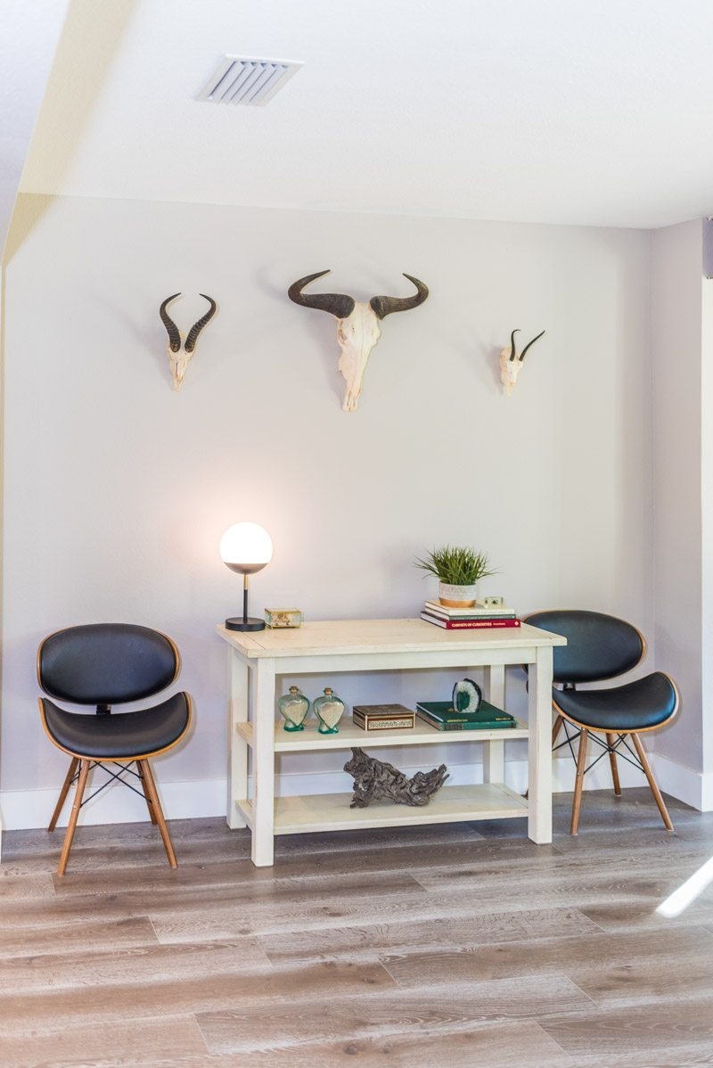 sideboard and chairs in midcentury minimalist home in st augustine florida