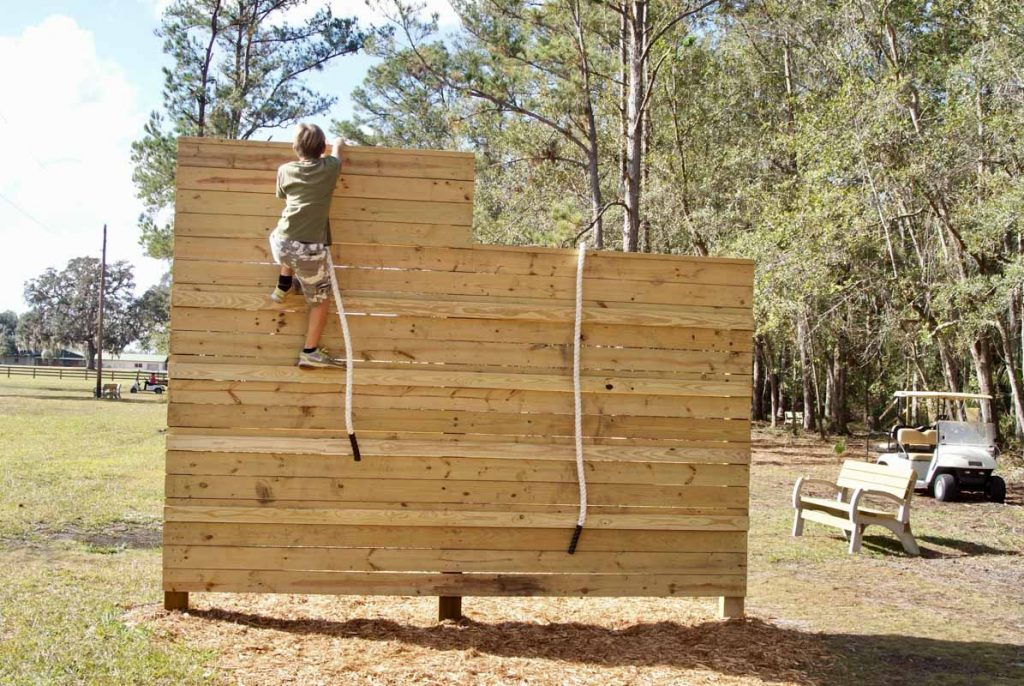 Rodheaver boys climb an obstacle at their newly funded course in palatka florida