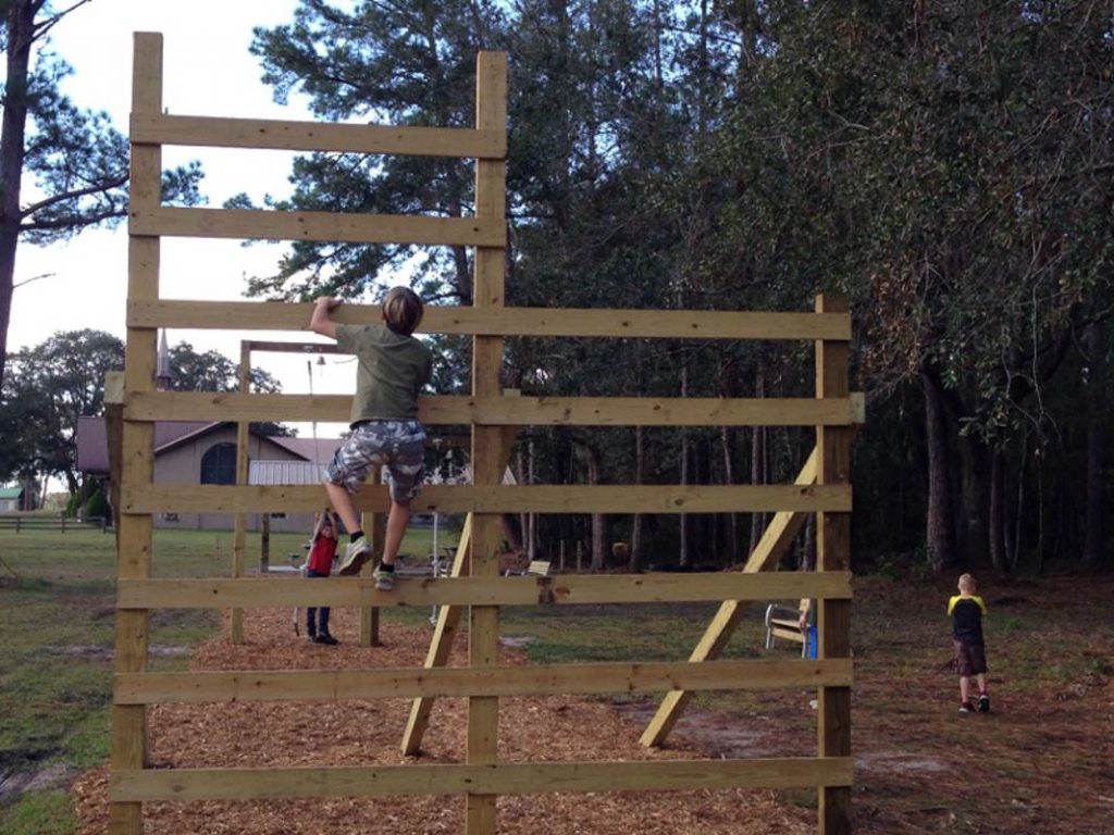 boys climb the obstacle course at rodeheaver boys ranch in palatka florida