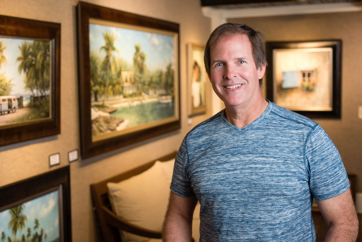 tripp harrison stands in his st augustine gallery