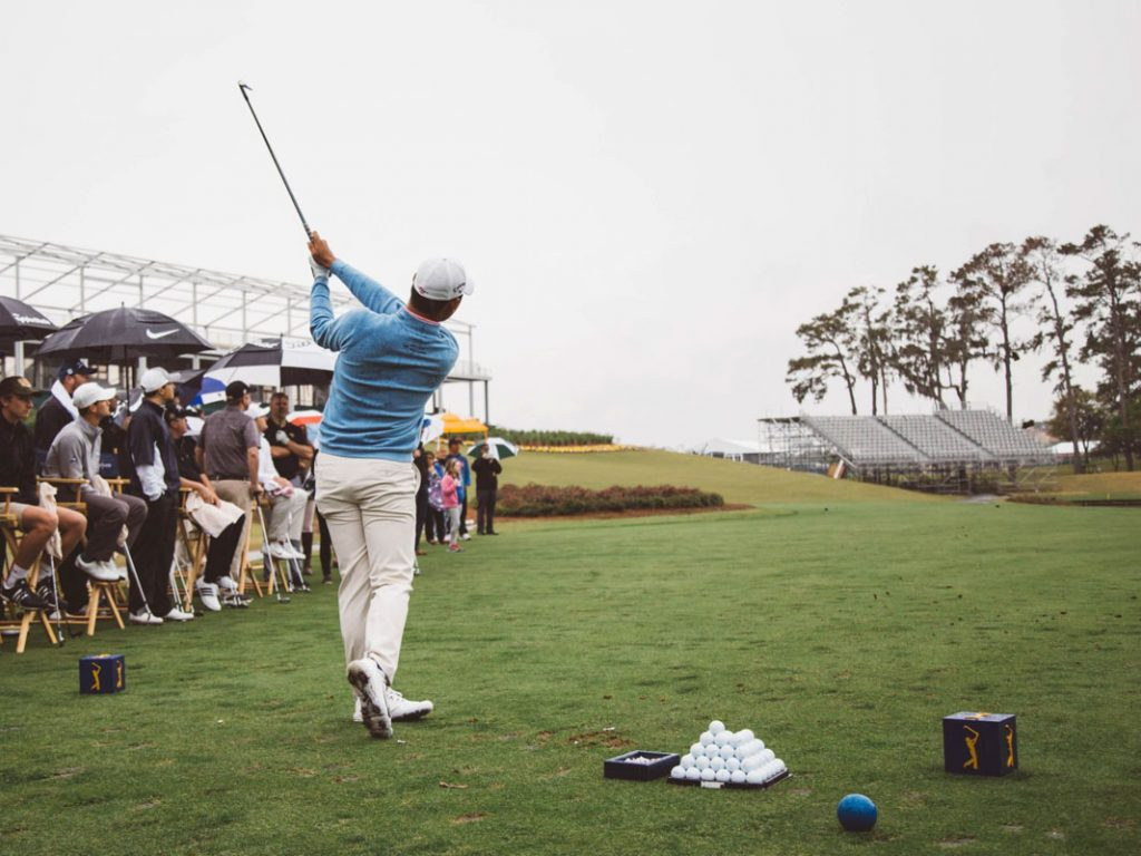 a players practices his swing at the players championship at tpc sawgrass