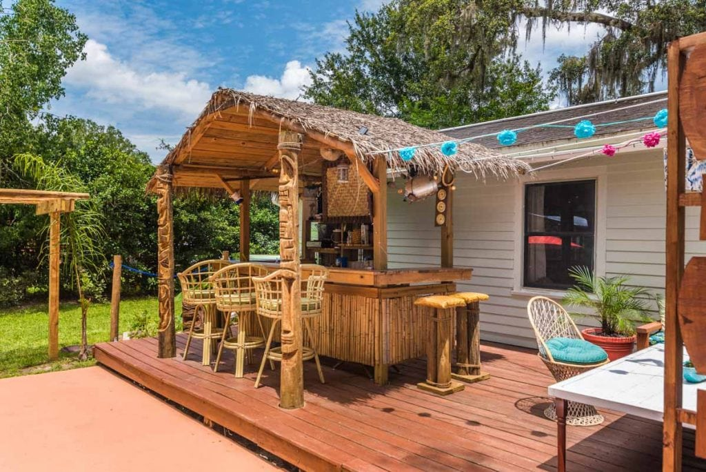 backyard tiki bar at mid century st augustine home