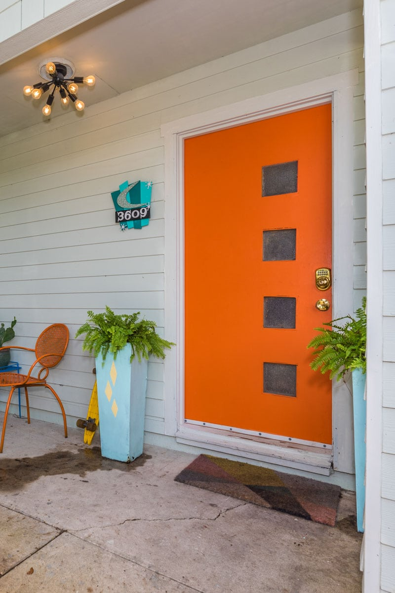 orange front door of the mid-century kitsch mccarty home