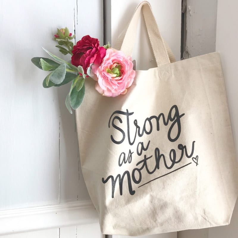 strong as a mother tote bag from declaration and co st augustine