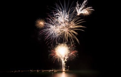 large fireworks display over water