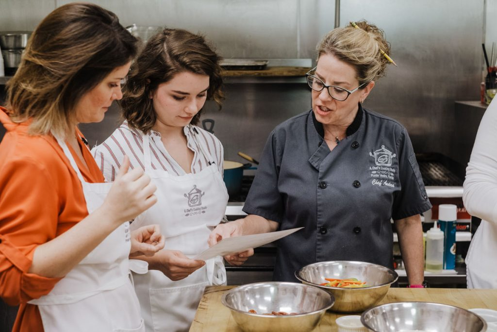 the st augustine social team takes a cooking class at a chef's cooking studio