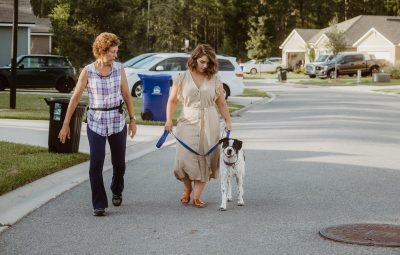 julie parker and molly wilson lead dog during training session