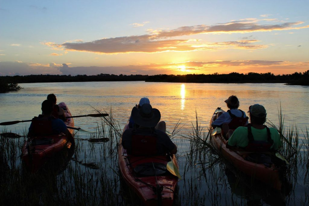 sunset from a kayak with ripple effect eco tours
