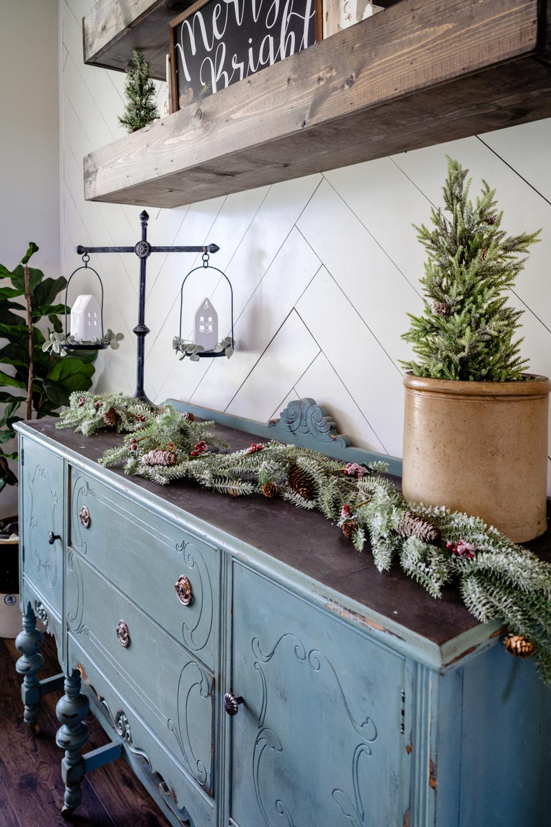 sideboard in matt and tracy's st augustine farmhouse decorated for christmas