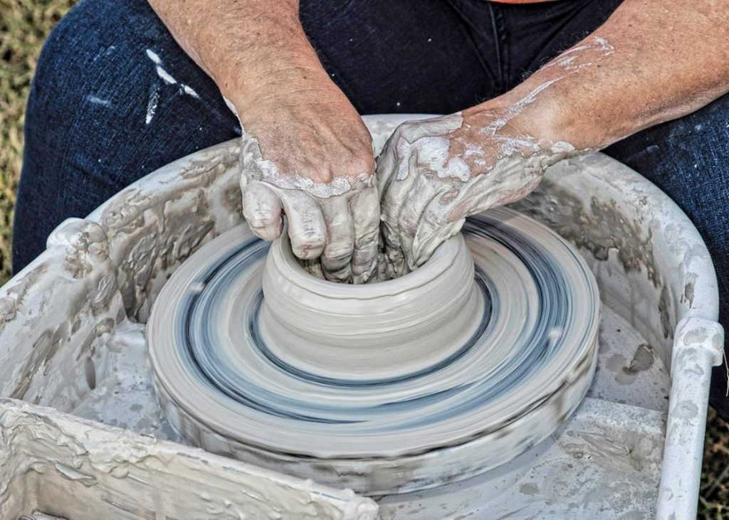 an artist makes pottery at the st augustine festival of art