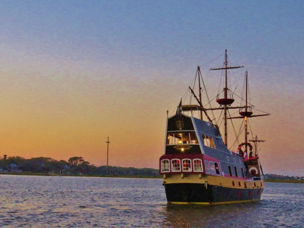 the black raven pirate ship in the sunset