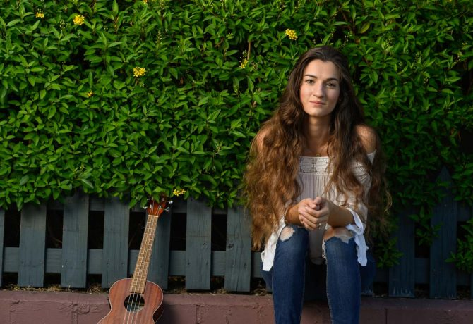 st augustine musician jolie sits with her ukelele