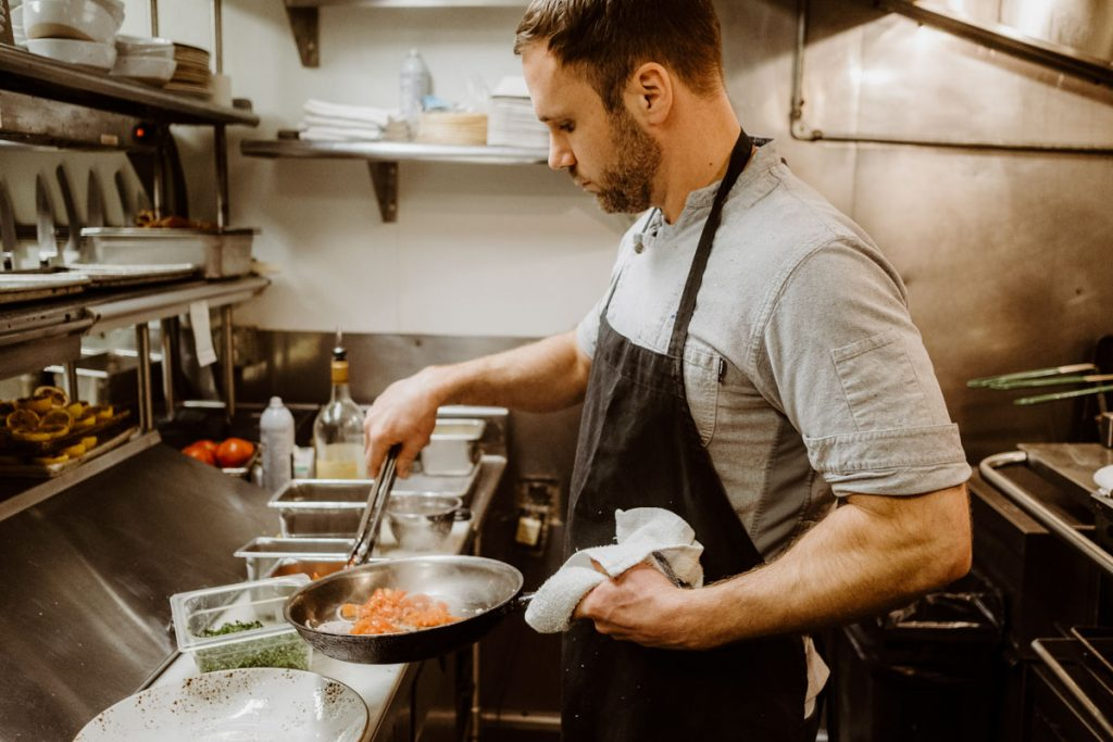 chef laird boles creates a dish in the kitchen of ice plant st augustine