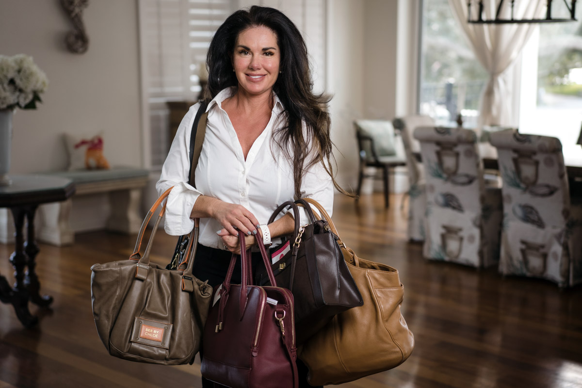 hopefull handbags founder cathlene miner with an armful of handbags