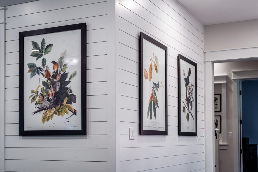prints in the hallway of longleaf house in st johns county