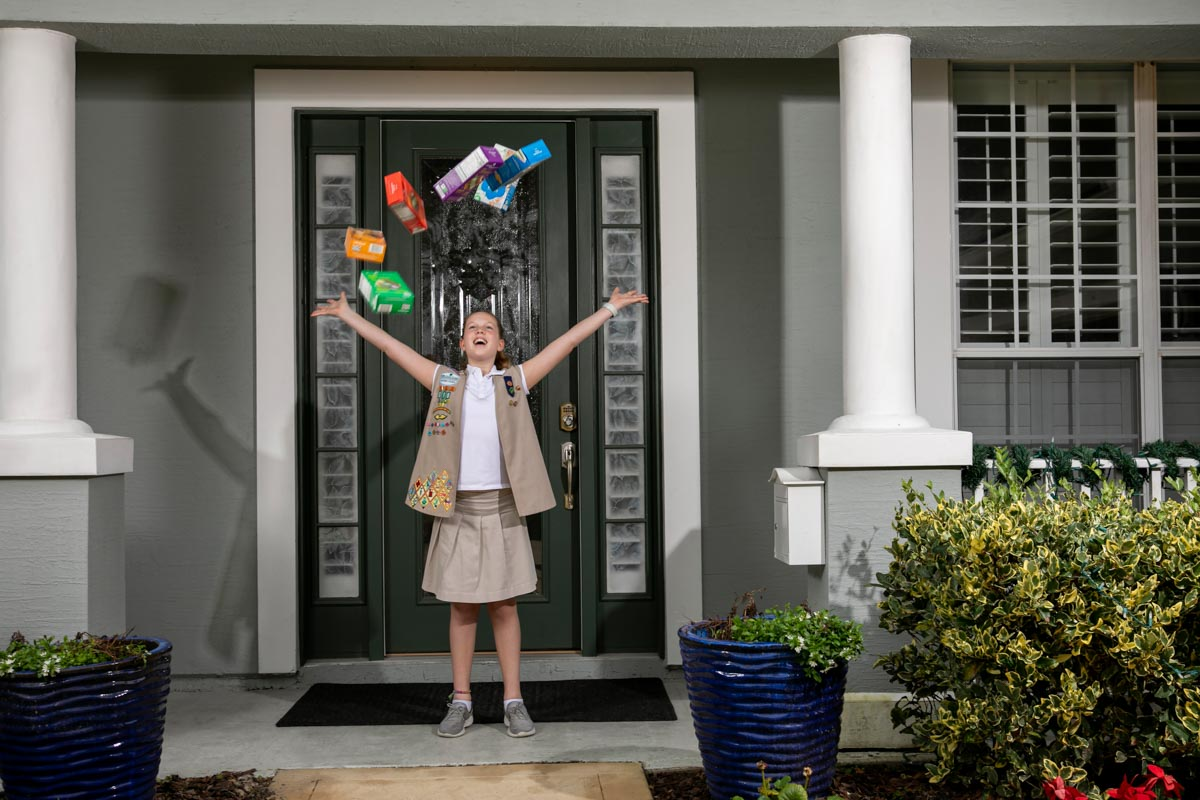 girl scout jane hershiser throws cookie boxes in the air