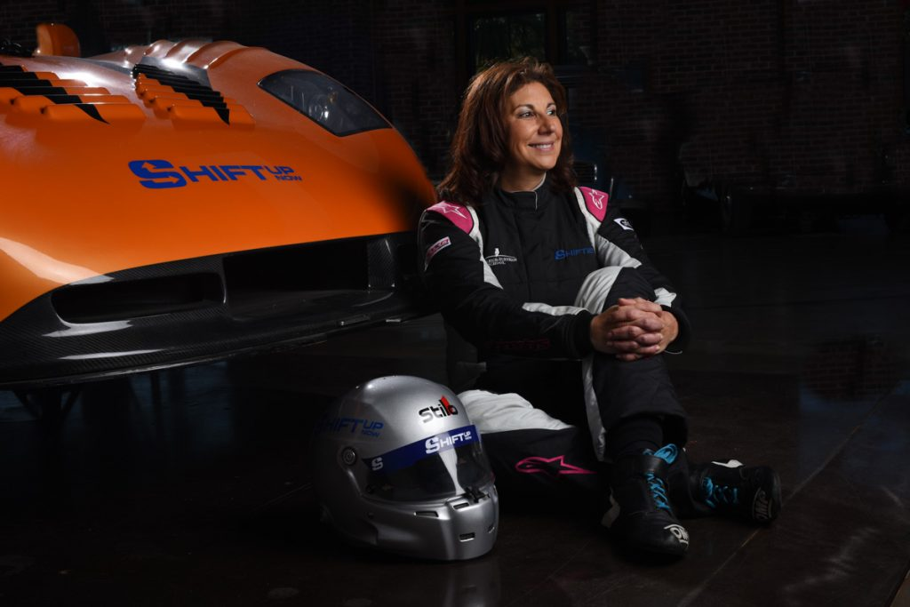 lynn kehoe of shift up now racing and a race car