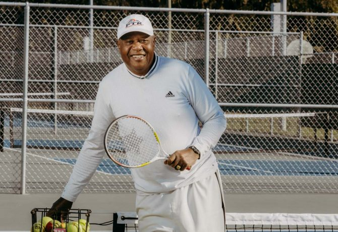 st augustine tennis instructor harold hardy gets ready to serve
