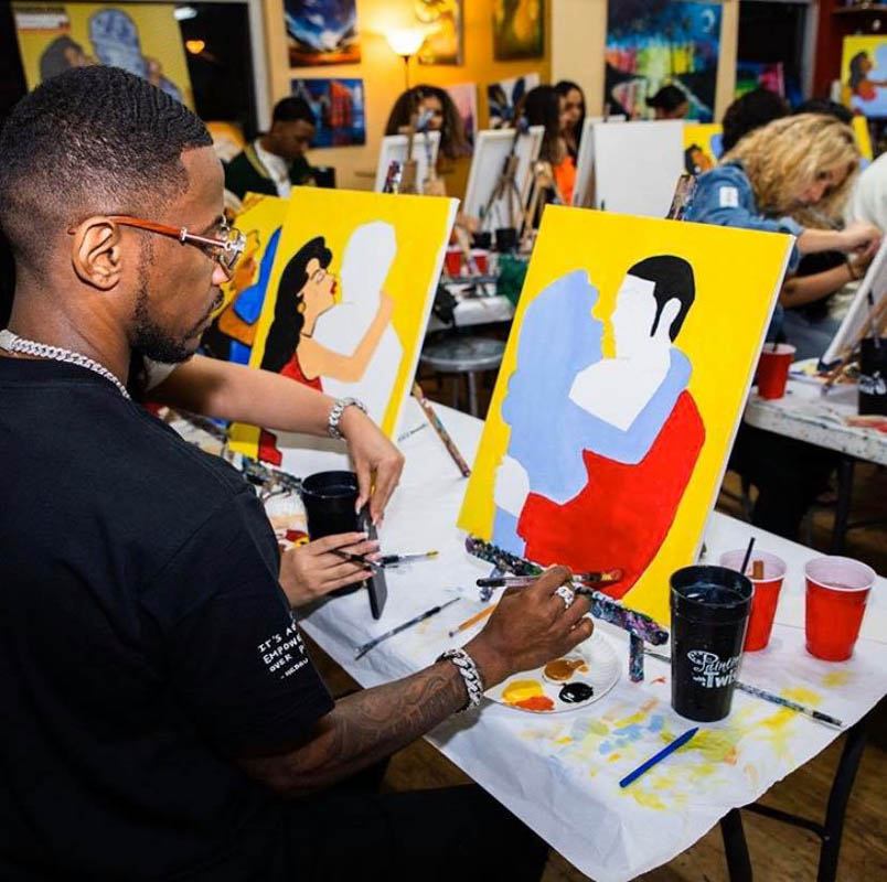 guests paint together at painting with a twist