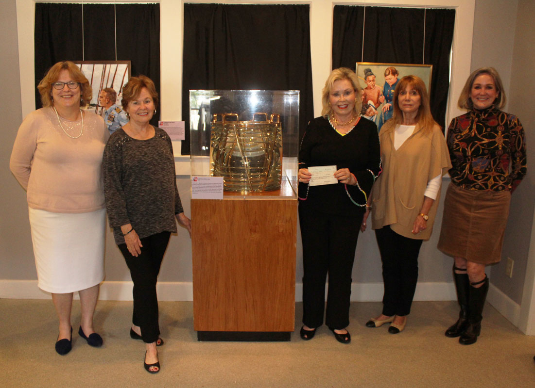 the questers ponte vedra stand next to their sponsored artifact an historical lens