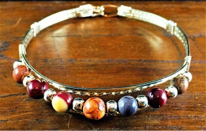 a silver and bead bracelet sold at sta marketplace