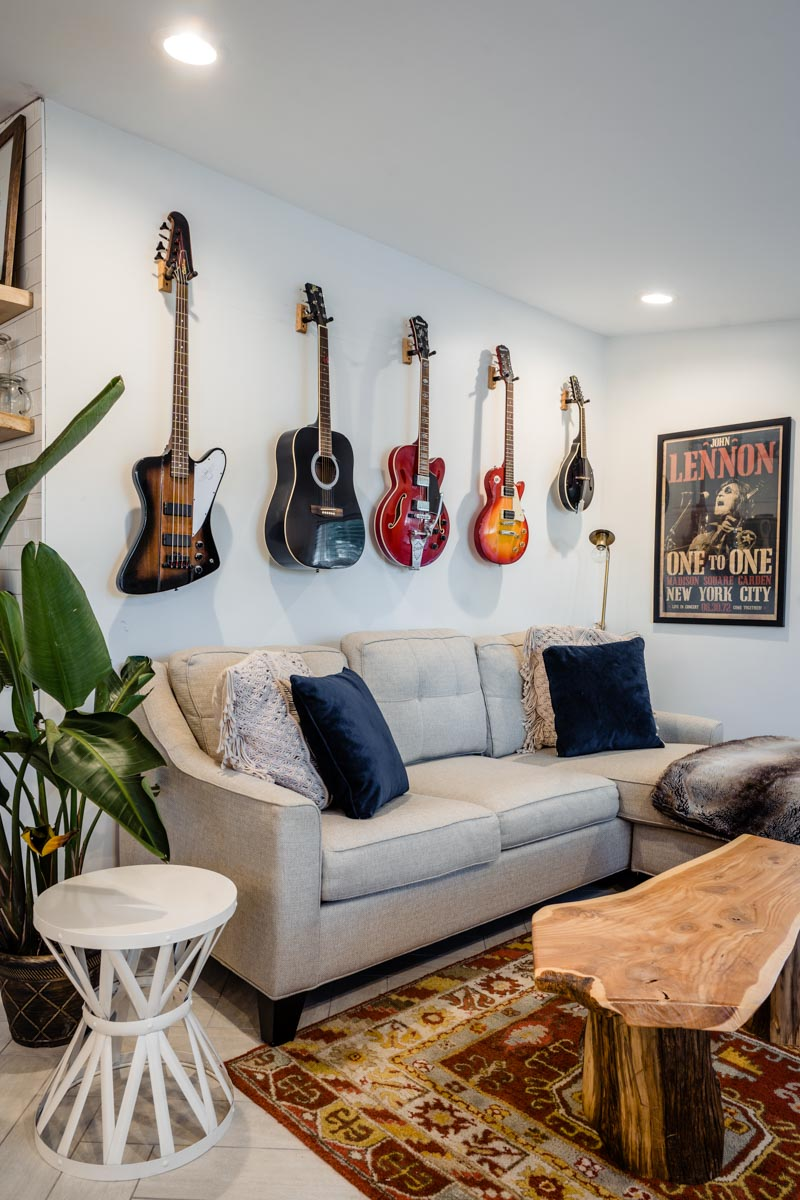 family room with guitars hanging on the wall