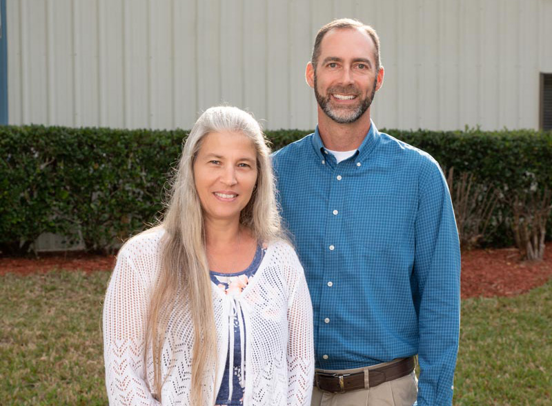 andrew gause and mona stout of powell ac stand in front of their building